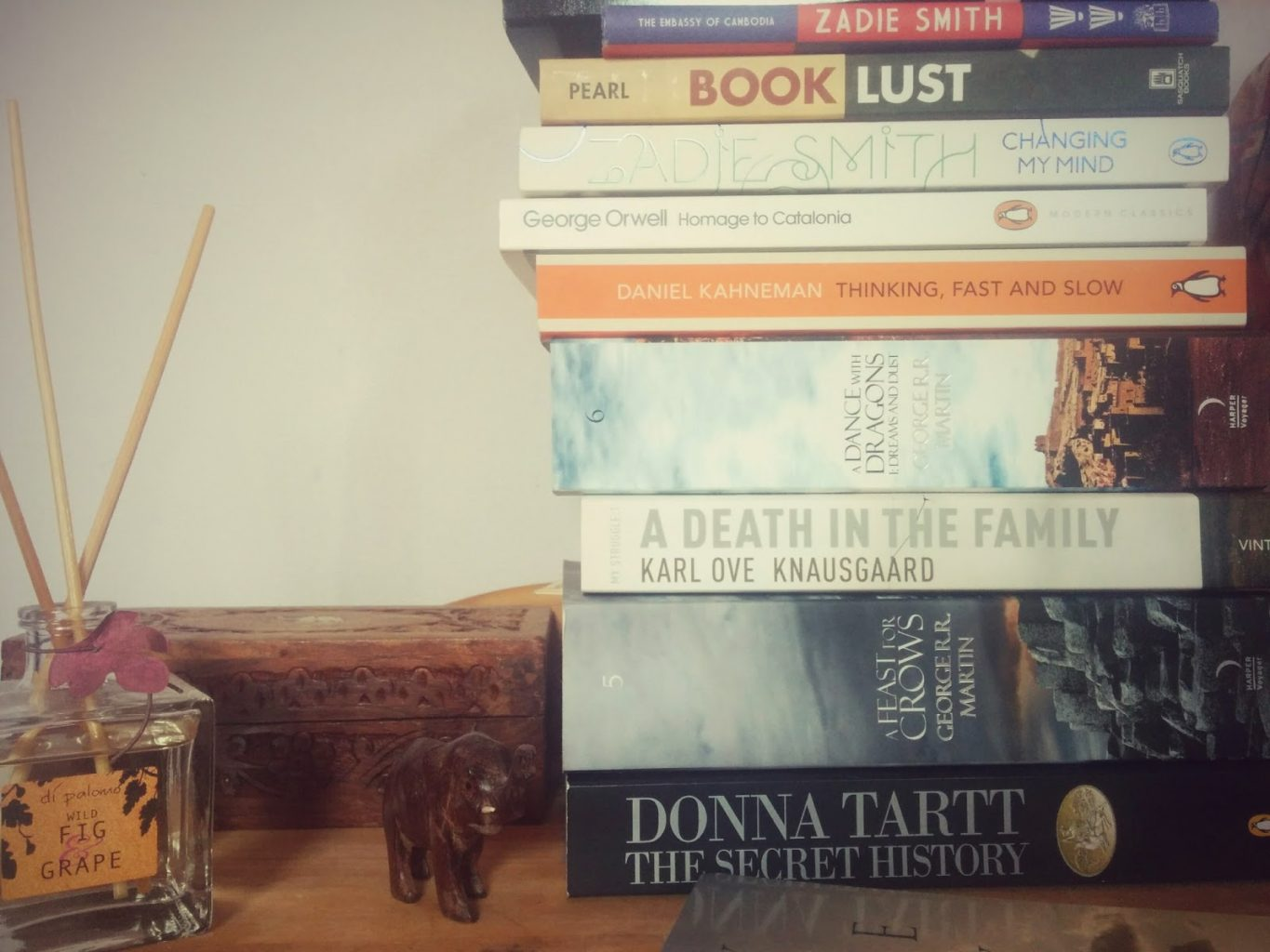 My to-read pile, featuring The Secret History and A Feast for Crows